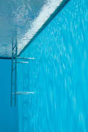 photo of underwater view of a pool ledge with a ladder