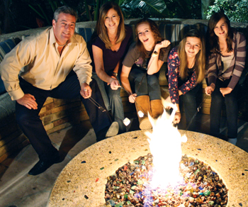 photo of Cohen family around fire pit
