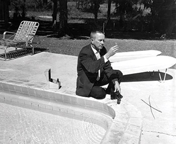 photo of a man testing pool water in 1961