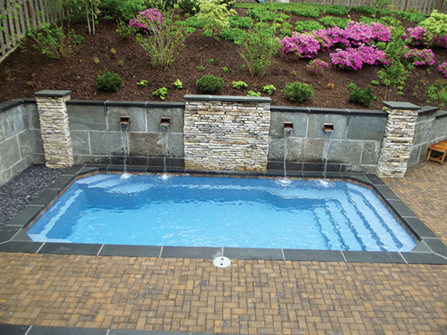 A small space fiberglass pool installation aqua magazine for Fiberglass pool installation