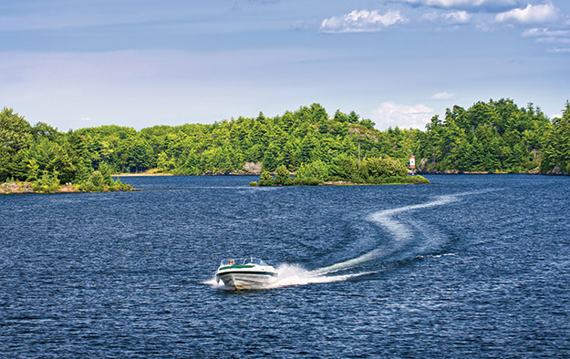 photo of a speed boat out on a lake