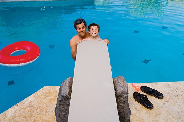 photo of a man and a boy at a diving board