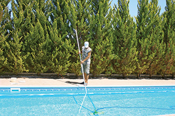 photo of a pool service person