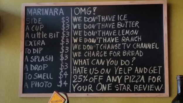 photo of a restaurant chalkboard featuring complaints from Yelp.