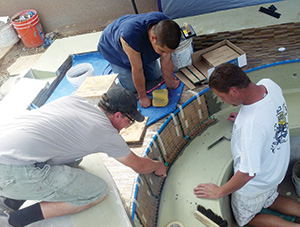 photo of glass pool tile installation
