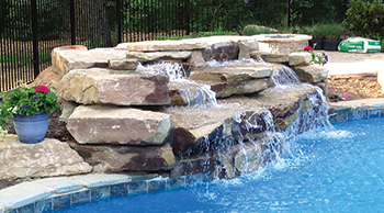 photo of a pool fountain feature