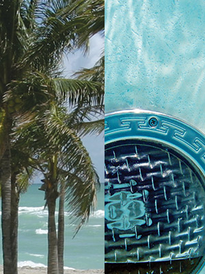 photo of palm trees near the ocean and a pool drain