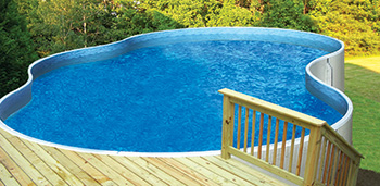 photo of an aboveground pool in a sloped backyard
