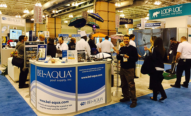 AQUA Executive Editor Scott Webb in front of the Bel-Aqua booth at the Pool & Spa Show.