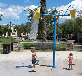 Two children playing at a splashpad