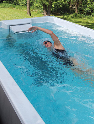 photo of a woman using a swim spa