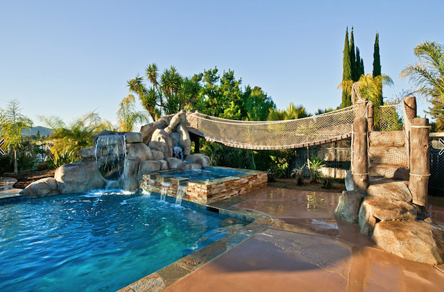 Considering A Pool Slide Here S What You Need To Know Aqua Magazine