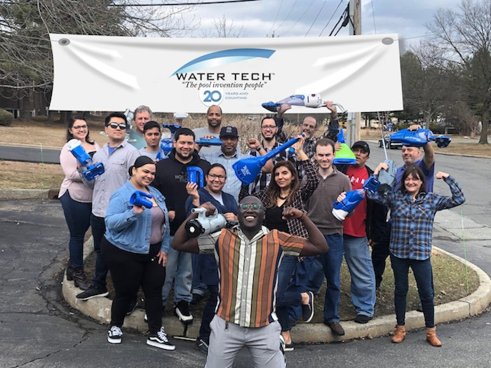 The Water Tech team celebrates at their offices this past month.