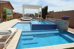 Category: SPAS BUILT IN CONJUNCTION WITH SWIMMING POOLS By: Paragon Pools, Las Vegas, Nev.
