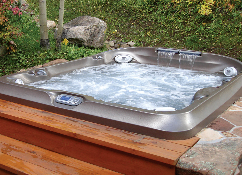 Traditional Portable Spas Can Take On The Custom Look When Paired With  Creative Hardscape Surrounds That Help Visually Blend Vessels With The  Setting.